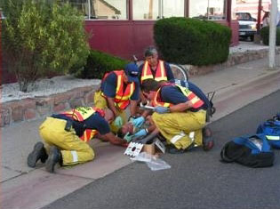 firefighters rescuing a person