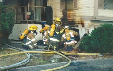 firefighters at a house