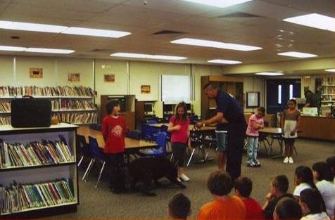 firefighter teaching kids