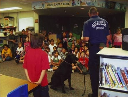 firefighter and dog teaching kids