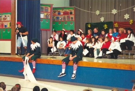 people on a stage dressed as elves